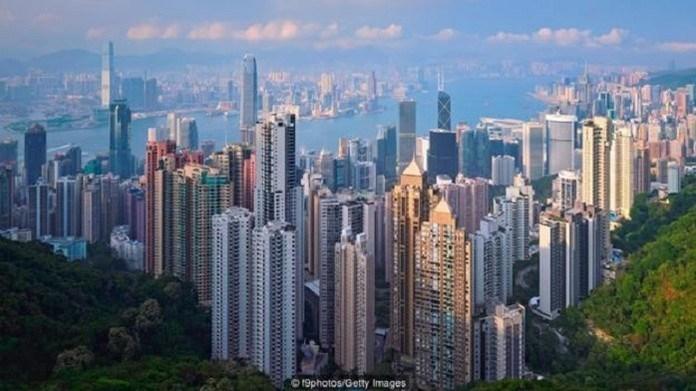 Giới đầu tư đại lục đua nhau bán tháo nhà tại Hong Kong - 1